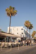 Pedestrians walking by apartment buildings against clear sky, Paphos, Cyprus