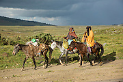 Local indigenous people, on horseback, on their way to the local market. Bale Mountains, Ethiopia, Africa