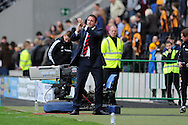 Cardiff city manager Malky Mackay salutes the fans after the match as he  looks happy with the draw and a point.  Barclays Premier league match, Hull city v Cardiff city at the KC Stadium in Hull on Sat 14th Sept 2013. pic by Andrew Orchard, Andrew Orchard sports photography,