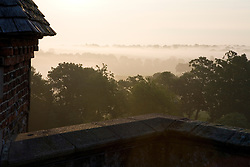 View of the countryside from the Tower at Sissinghurst Castle Garden on a misty morning at dawn
