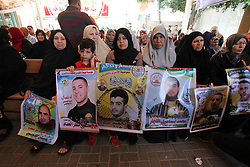 May 27, 2019 - Gaza City, Gaza Strip, Palestinian Territory - Palestinians take part in a protest to show solidarity with Palestinian Prisoners held in Israeli jails, in front of Red Cross office, in Gaza city, on May 27, 2019  (Credit Image: © Mahmoud Ajjour/APA Images via ZUMA Wire)