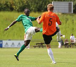 Ousmane Seck (Avarta) og Jeppe Christiansen (FC Helsingør) under kampen i 2. Division Øst mellem Boldklubben Avarta og FC Helsingør den 19. august 2012 i Espelunden. (Foto: Claus Birch).