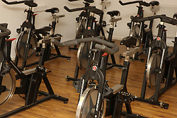 Exercise bikes in gym.