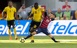 July 26, 2017 - Santa Clara, CA, USA - Santa Clara, CA - Wednesday July 26, 2017: Je-Vaughn Watson and Paul Arriola during the 2017 Gold Cup Final Championship match between the men's national teams of the United States (USA) and Jamaica (JAM) at Levi's Stadium. (Credit Image: © Bob Drebin/ISIPhotos via ZUMA Wire)