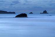 Dusk on the sand coast with rock islands, Cantabria, Spain<br /> <br /> Abenddämmerung an der Sandküste mit Felsinseln, Cantabria, Spain