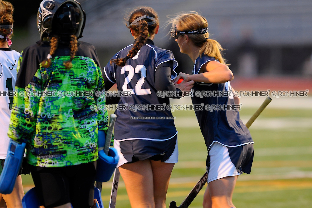 Hannah Bjornson handing the ball to Emily Ashken after Emily scored.