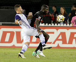 September 9, 2017 - Washington, DC, USA - 20170909 - D.C. United defender KOFI OPARE (6) pushes off Orlando City FC forward DOM DWYER (18) as they pursue a play on the ball in the first half at RFK Stadium in Washington. (Credit Image: © Chuck Myers via ZUMA Wire)