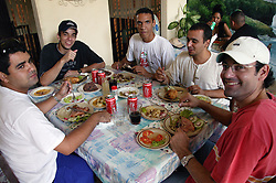 Group of men eating in a private restaurant in Pinar del Rio; Cuba,