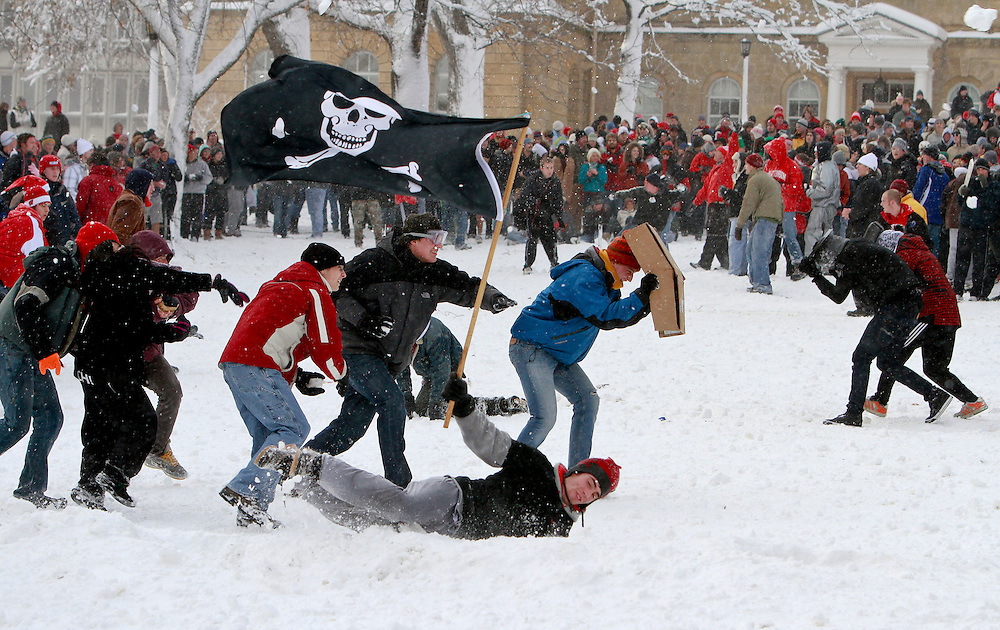 University of Wisconsin-Madison students battle in a campus-wide snowball fight on Bascom Hill in Madison, Wis. (Photo @ Andy Manis)