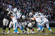 Oakland Raiders defensive end Khalil Mack (52) strips the ball from Carolina Panthers quarterback Cam Newton (1) late in the fourth quarter at Oakland Coliseum in Oakland, Calif., on November 27, 2016. (Stan Olszewski/Special to S.F. Examiner)
