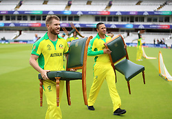 Australia's David Warner carries his chair back to the pavillion during a nets session at Lord's, London.