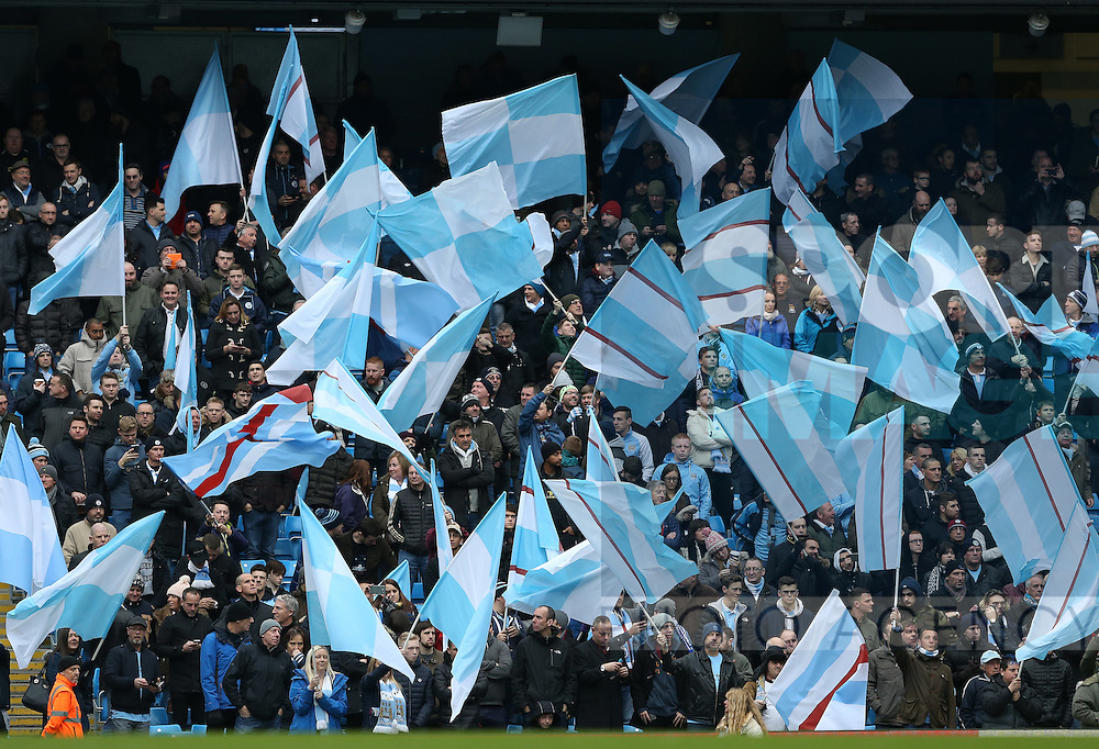 Manchester City fans wave flags during the Premier League match at the Etihad Stadium, Manchester. Picture date: December 3rd, 2016. Pic Simon Bellis/Sportimage