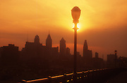 Philadelphia Skyline, Ben Franklin Bridge, Silhouette looking West, Sunset
