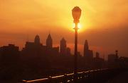 Philadelphia Skyline, Ben Franklin Bridge, Silhouette looking West, Sunset