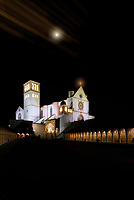 """""""Midnight snow glow of the Papal Basilica of San Francesco di Assisi - Stella""""...<br /> <br /> Upon arrival early that day in Assisi, I began taking photos the second I parked at Hotel Giotto just inside the walls in the foothills of Assisi. Perhaps Saint Francis arranged the dramatically perfect skies and coordinated every encounter. Beginning at the Basilica of Saint Frances, every second of the climb to the top of the mountain to the fortress Rocca Maggiore, a new surprise awaited around every corner. Never stopping for lunch or dinner, I continued to photograph new images well past sundown. Traversing the narrow steps and strada back down to the bottom of the mountaintop to my hotel, the walk seemed a bit less strenuous and I felt a sense of gratitude and completion of my day long journey. However, the very quiet Assisi seemed to have fallen into a deep slumber in the early nighttime leaving all the restaurants closed for the night. Pleading with the hotel manager, she desperately arranged a late dinner at one of the most iconic restaurants in Assisi, La Locanda Del Cardinale, which was built over an ancient Roman settlement dating from the first century B.C., with glass floors to view the mosaics below. Walking back at midnight to the hotel, the peaceful Assisi continued to call out. As the serene, quiet Basilica of Saint Francis stood majestically and glowed in the midnight skies, one could not help but to acquiesce to its mystical yearning for just a few more memorable portraits in the cool dew of the early morning air."""
