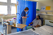 Ste0098599 . Daily Telegraph<br /> <br /> DT News<br /> <br /> Covid <br /> <br /> Matron Gill Burnell speaking with Covid patient Jasbir Singh , 51 yrs on 6 North Covid Ward  .<br /> <br /> <br /> Ealing Hospital currently has 170 Covid patients 10 of which are in the Intensive Care Unit .<br /> <br /> Ealing is a district general hospital and part of London North West University Healthcare NHS Trust, located in the Southall district of the London Borough of Ealing in West London .<br /> <br /> London 22 January 2021