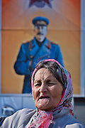 Moscow, Russia, 01/05/2005..Demonstrators from a wide range of political groups take to the streets on the traditional Russian Mayday holiday to protest against President Vladimir Putin and the Russian government..A Communist demonstrator in front of a large portrait of Stalin.