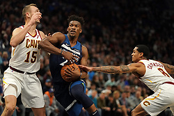 October 19, 2018 - Minneapolis, MN, USA - The Minnesota Timberwolves' Jimmy Butler drives to the basket as the Cleveland Cavaliers' Sam Dekker (15) and Jordan Clarkson (8) defend in the first half on Friday, Oct. 19, 2018, at the Target Center in Minneapolis. (Credit Image: © Anthony Souffle/Minneapolis Star Tribune/TNS via ZUMA Wire)