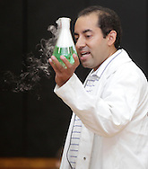 Middletown, New York - Erik Maldonado holdsa beaker full of water and dry ice during a Mad Science demonstration at Middletown YMCA summer camp on Aug. 20, 2010.