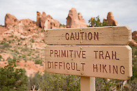 Primitive hiking trail sign in Arches National Park near Moab, Utah.