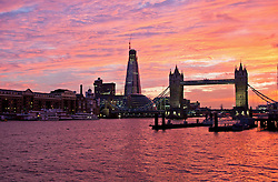 © licensed to London News Pictures.  23/08/2011. London, UK. A stunning pink and orange sunset over Tower Bridge on the River Thames, London yesterday evening (22/08/2011) Photo credit :Vickie Flores/LNP