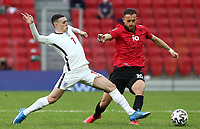 TIRANA, ALBANIA - MARCH 28: Sokol Cikalleshi of Albania is dispossessed by Phil Foden of England during the FIFA World Cup 2022 Qatar qualifying match between Albania and England at the Qemal Stafa Stadium on March 28, 2021 in Tirana, Albania. Sporting stadiums around Europe remain under strict restrictions due to the Coronavirus Pandemic as Government social distancing laws prohibit fans inside venues resulting in games being played behind closed doors (Photo by MB Media)