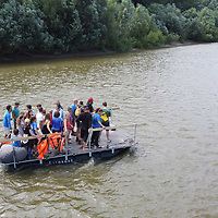 Volunteers of the PET Cup plastic waste recovery challenge collect trash from river Tisza in Dombrad, Hungary on Aug. 5, 2020. ATTILA VOLGYI