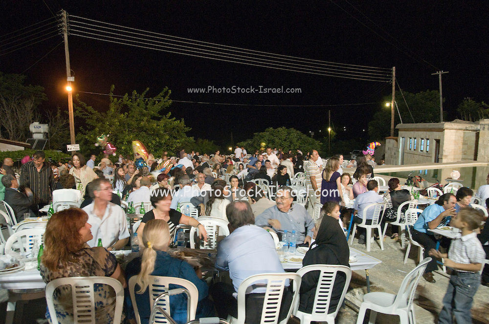 Cyprus, Lysos, A typical Cypriot Greek wedding in the town square all are invited. Three thousand people from the village and near by villages were expected. Tables and chairs set out for the guests .