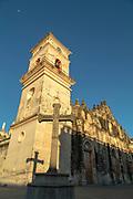 Exterior of an old church under a clear blue sky, La Merced church, Granada, Nicaragua