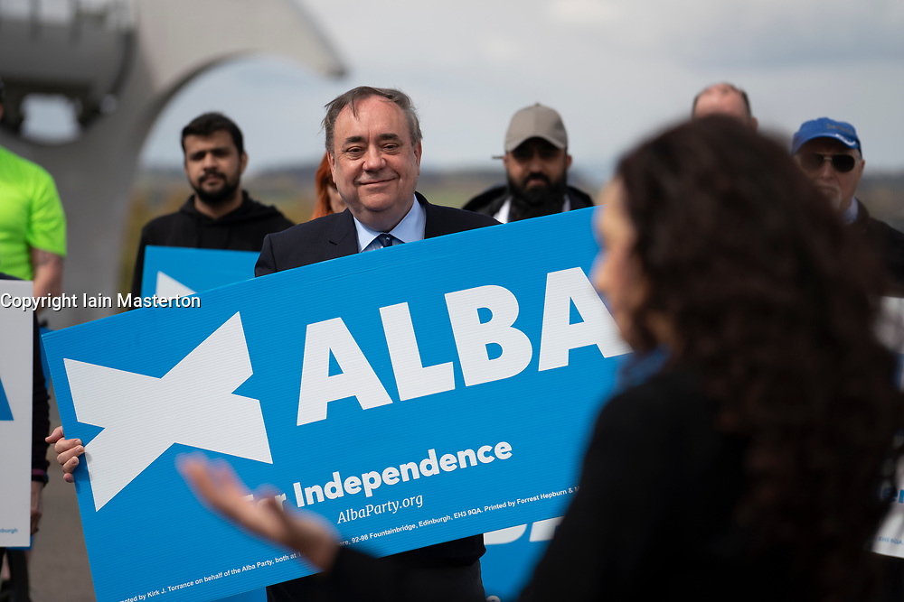 Falkirk, Scotland, UK. 30 April 2021. Leader of the pro Scottish nationalist Alba Party , Alex Salmond, campaigns with party supporters at the Falkirk Wheel ahead of Scottish elections on May 6th. Pic; Alex Salmond watches Tasmina Ahmed-Sheikh. Iain Masterton/Alamy Live News