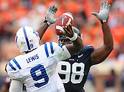 Virginia NT Nate Collins (98) eyes Duke quarterback Thaddeus Lewis (9) during an ACC football game Saturday in Charlottesville, VA. Duke won 28-17. Photo/Andrew Shurtleff
