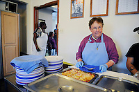 Sister Barbara Muck behind the lunch line at the First United Methodist Church in Salinas, California. Volunteers from the community drive a program that provides meals, counseling resources and occasional shelter to people in need.