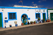 Traditional architecture pretty house painted blue and white, Las Salinas del Carmen, Fuerteventura, Canary Islands, Spain