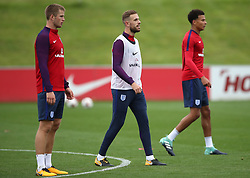 England's Eric Dier (left), Jordan Henderson (centre) and Dele Alli during a training session at St Georges' Park, Burton.