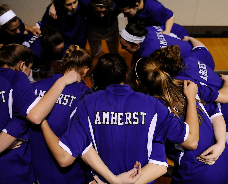 Amherst College players huddle together before a game against Hamilton College, Friday, Jan. 9, 2015, in Amherst, Mass.  Amherst has broken UConn's women's NCAA record with 104 consecutive home victories and is closing in on the Kentucky men's record of 120-plus wins set decades ago. (Jessica Hill for the New York Times)