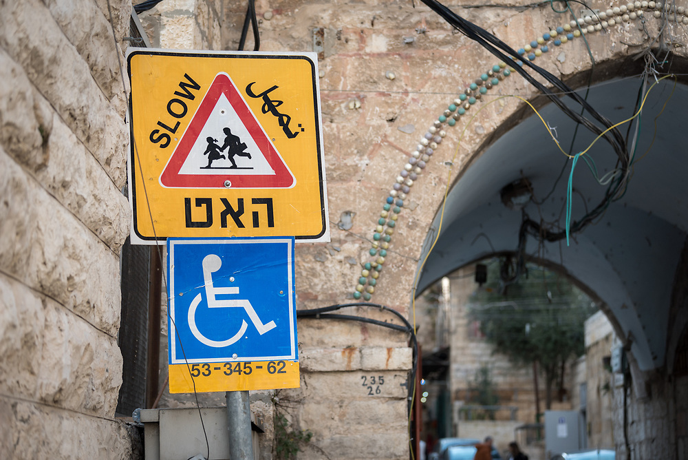 23 February 2020, Jerusalem: 'Slow' reads a road sign in the Jerusalem Old City, displaaying children playing and a person in a wheelchair.