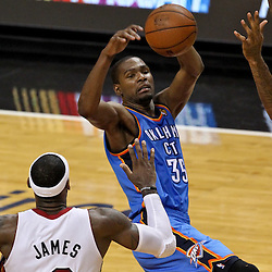 Jun 21, 2012; Miami, FL, USA; Oklahoma City Thunder small forward Kevin Durant (35) loses the ball as Miami Heat power forward Udonis Haslem (40) and small forward LeBron James (6) defend during the fourth quarter in game five in the 2012 NBA Finals at the American Airlines Arena. Mandatory Credit: Derick E. Hingle-US PRESSWIRE