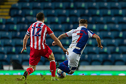 BLACKBURN, ENGLAND - Saturday, January 16, 2021: Stoke City's James Chester (L) fouls Blackburn Rovers' Adam Armstrong, leading to a red card, during the Football League Championship match between Blackburn Rovers FC and Stoke City FC at Ewood Park. The game ended in a 1-1 draw. (Pic by David Rawcliffe/Propaganda)