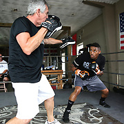 """WINTER HAVEN, FL - MAY 05: Boxer Willie Monroe Jr. (R) works the mitts with Danny Akers at the Winter Haven Boxing Gym on May 5, 2015 in Winter Haven, Florida. Monroe will challenge middleweight world champion Gennady """"GGG"""" Golovkin for the WBA world championship title in Los Angeles on May 16.  (Photo by Alex Menendez/Getty Images) *** Local Caption *** Willie Monroe Jr.; Danny Akers"""