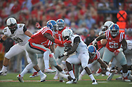 Vanderbilt Commodores running back Ralph Webb (7) is tackled by Mississippi Rebels defensive end Marquis Haynes (27) at Vaught-Hemingway Stadium at Ole Miss in Oxford, Miss. on Saturday, September 26, 2015. (AP Photo/Oxford Eagle, Bruce Newman)