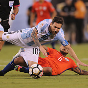 EAST RUTHERFORD, NEW JERSEY - JUNE 26: Lionel Messi #10 of Argentina is fouled by Arturo Vidal #8 of Chile during the Argentina Vs Chile Final match of the Copa America Centenario USA 2016 Tournament at MetLife Stadium on June 26, 2016 in East Rutherford, New Jersey. (Photo by Tim Clayton/Corbis via Getty Images)