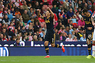 Son Heung-Min of Tottenham Hotspur celebrates after scoring his teams 2nd goal.  Premier league match, Stoke City v Tottenham Hotspur at the Bet365 Stadium in Stoke on Trent, Staffs on Saturday 10th September 2016.<br /> pic by Chris Stading, Andrew Orchard sports photography.