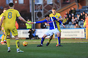 Ollie Rathbone challenged by Tom Lockyer during the EFL Sky Bet League 1 match between Rochdale and Bristol Rovers at Spotland, Rochdale, England on 4 February 2017. Photo by Daniel Youngs.