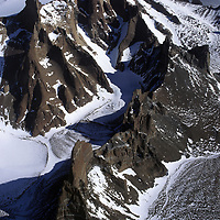 Rock spires tower over glaciers in the Wolthat Mountains, Queen Maud Land, Antarctica.