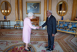 Governor-General of the Solomon Islands, Frank Kabui, presents his credentials to Queen Elizabeth II during a private audience at Buckingham Palace, London.