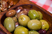 Bowls of Green and black olives served as appetizers