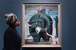 "© Licensed to London News Pictures. 04/06/2018. LONDON, UK. A gallery staff member views ""Celebes"", 1921, by Max Ernst at a preview of ""Aftermath:  Art in the wake of World War One"" at Tate Britain.  The exhibition marks 100 years since the end of the First World War, exploring the impact of the conflict on British, German, and French art in over 150 works from 1916 to 1932.  The show runs 5 June to 23 September 2018.  Photo credit: Stephen Chung/LNP"