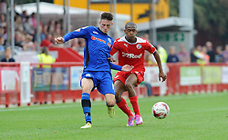 Crawley's Lewis Young tussles for the ball with Rochdale's Scott Tanser - photo mandatory by-line David Purday JMP- Tel: Mobile 07966 386802 - 06/09/14 - Crawley Town v Rochdale - SPORT - FOOTBALL - Sky Bet Leauge 1 - London - Checkatrade.com Stadium