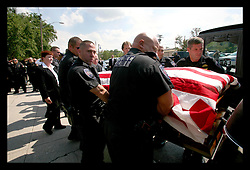 20 June, 2006. New Orleans, Louisiana. Funeral for police Captain Octavio 'Ox' Gonzalez, a St John the Baptist Parish Deputy Sheriff at St Catherine of Siena Catholic Church in Metairie. Hundreds of police officers turned out to remember their fallen comrade who was well loved and well known to fellow officers in and around the region. Captain Gonzalez, was ambushed by criminal John Lee Cheek (31 yrs) of Houston and his girlfriend Crystal Lynn Reed (27 yrs) late night on Friday 16th June, shot 3 times in the back. Part of the increasing crime wave in New Orleans.