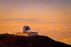 NASA Infrared Telescope Facility or IRTF of Mauna Kea Observatories, and silhouette of Haleakala of Maui at distance, Big Island, Hawaii